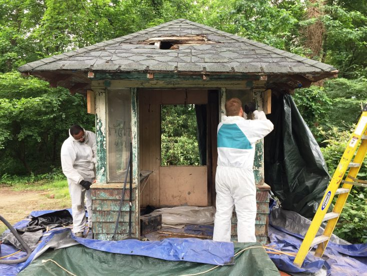 The Conservancy's summer interns restoring a historic Fairmount Park Guard Box.